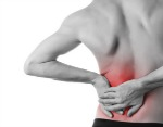 male hand on lower left back pain